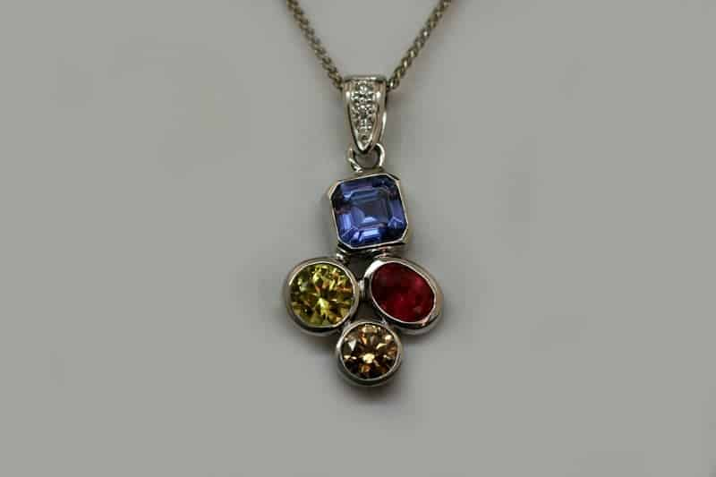 Birthday pendant - celebrating with the birthstones of the family members. We have gorgeous tanzanite, North Queensland yellow sapphire, Fair Trade ruby and Argyle cognac diamond and Argyle white accent diamonds in recycled 18 carat white gold.