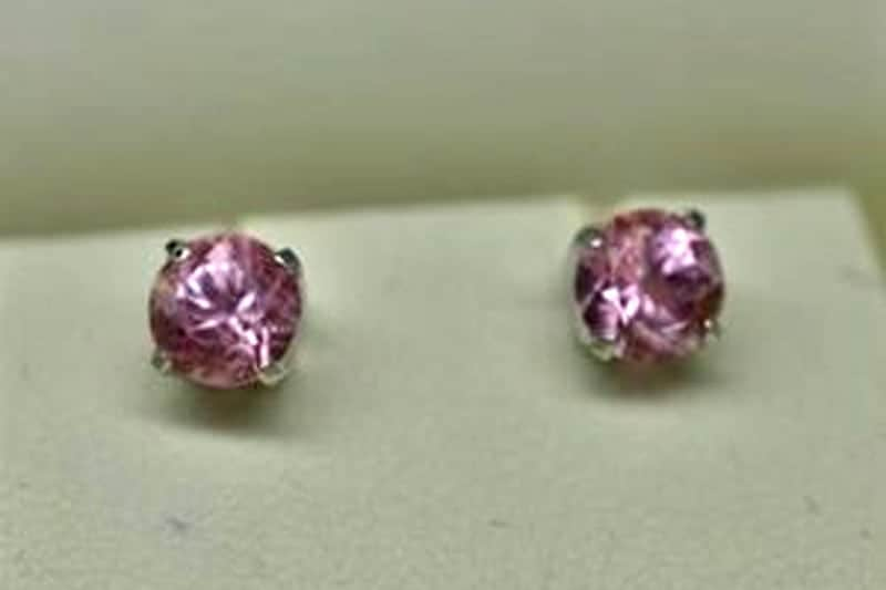 Image of a pair of earring studs. A sweet 16 present. Bubblegum pink USA tourmaline in recycled white gold.
