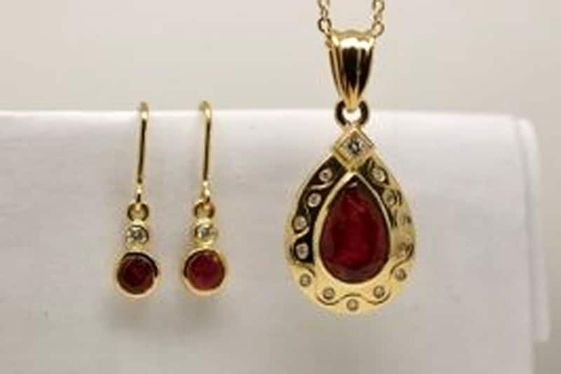 40th anniversary pendant and earrings. Fair Trade ruby and Argyle white diamonds in recycled 18 carat yellow gold.