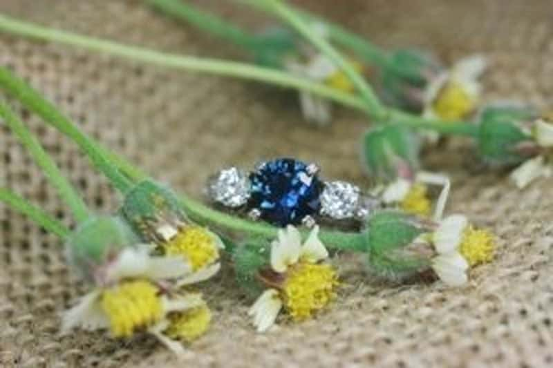 Image of blue Queensland sapphire and Argyle white diamond trilogy-style ring
