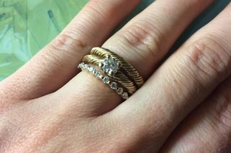 Engagement rings on fingers