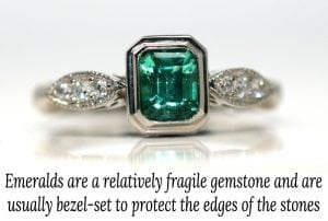 Image of an emerald gemstone bezel set in a ring to protect the stone's edges