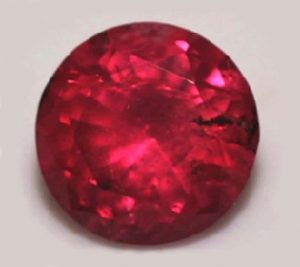 Fair Trade Tanzanian ruby showing an eye-visible inclusion at about 3 o'clock