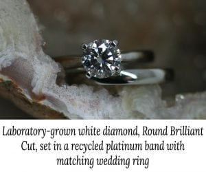 Image of a round brilliant white lab-grown diamond in a 4-claw setting