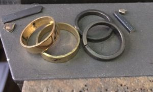 Image of recycled gold and platinum rings in the process of being made