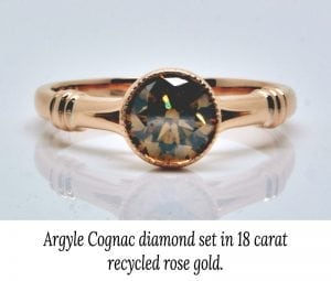 Image of a ring with a Argyle cognac diamond set in recycled 18 carat rose gold