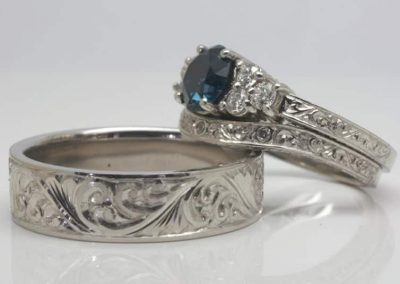 Blue sapphire engraved platinum wedding set