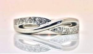 Image of a crossover-style diamond set wedding ring in recycled platinum