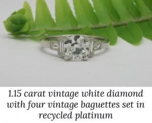Image of a recycled platinum deco-style engagement ring featuring a vintage round diamond and four vintage baguette diaomnds