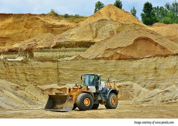 Image of a front end loader in an open cut mine pit