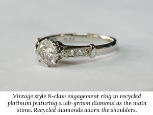 Image of a vintage style 8-claw platinum engagement ring with a lab-grown diamond as the main stone and recycled diamonds on the shoulders