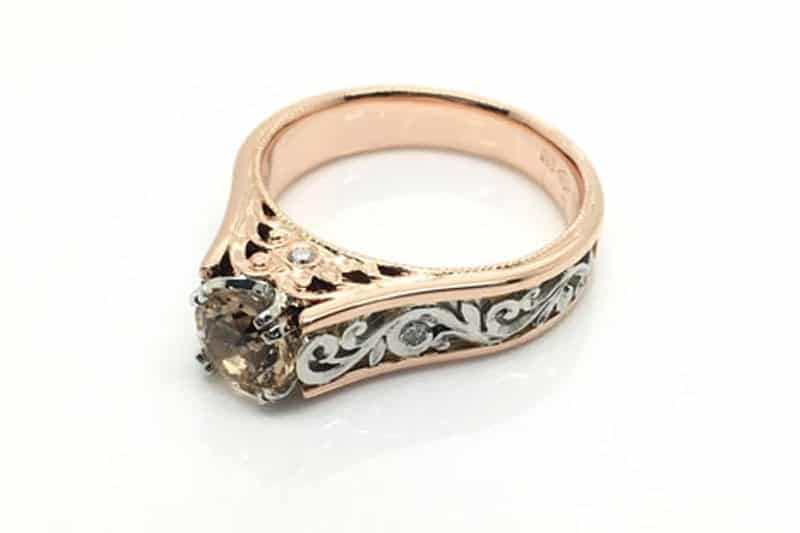 Ring image: Handmade engagement ring. With a band of recycled 18 carat rose gold, this ring features a central morganite in a claw setting. The band is set with engraved patterns made of recycled platinum.