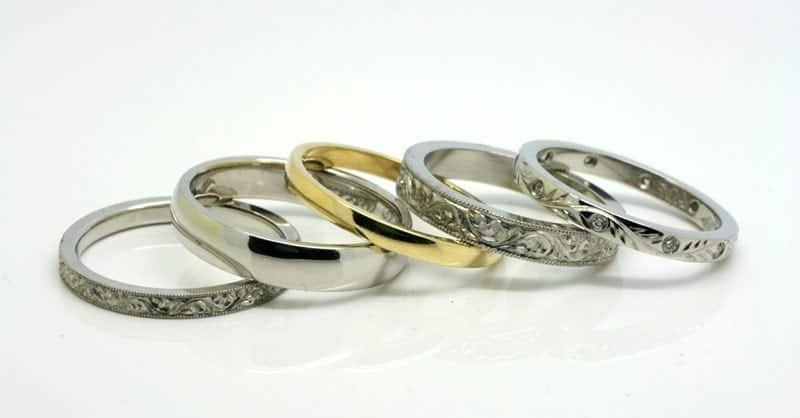 Image of five different wedding bands made of gold and platinum