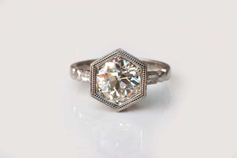 over one carat vintage white diamond in a hexagonal bezel setting in this vintage-style platinum ring