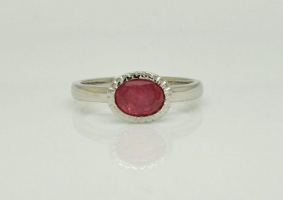 Fair Trade Ruby in zig zag bezel setting