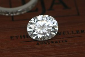 Photo of a brilliant white, oval cut Charles & Colvard moissanite