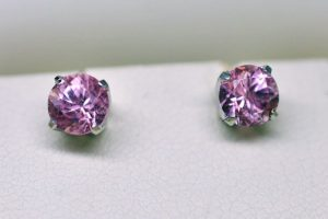 Photo of a matching pair of round pink tourmaline earring studs set in platinum