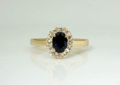 Blue sapphire halo ring with Chi Rho symbol