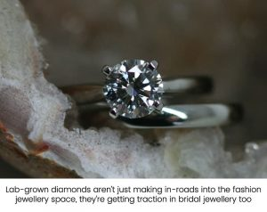 Photo of a four-claw lab-grown diamond engagement ring with its matching wedding ring - all in recycled platinum
