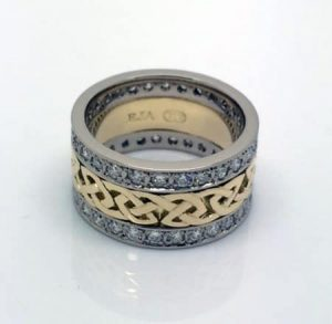 Image of a recycled gold Celtic-inspired ring with white gold diamond eternity bands either side is stunning - but was very complicated (and costly) to manufacture.