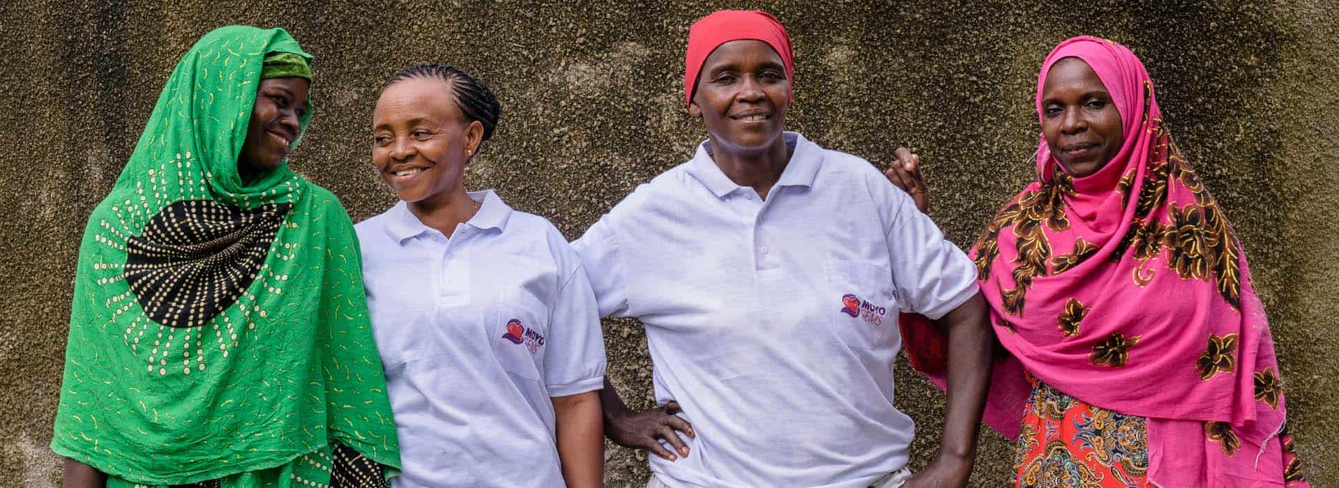 Four Tanzanian women engaged with Pact's Mines to Markets program