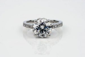 Four-claw Moissanite engagement ring with Argyle shoulder diamonds all set in a recycled platinum band