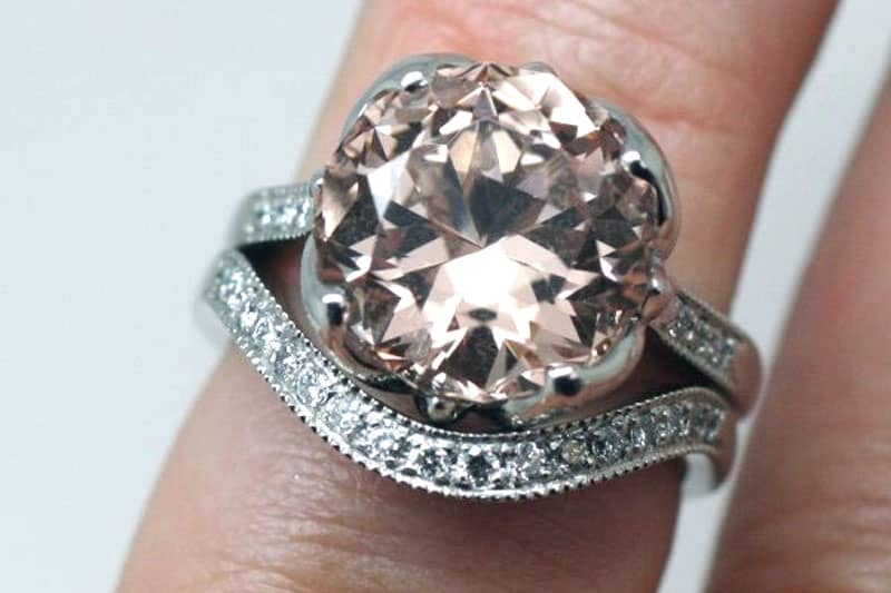 Very large Morganite engagement ring and matching diamond-set eternity style wedding ring both made with recycled platinum