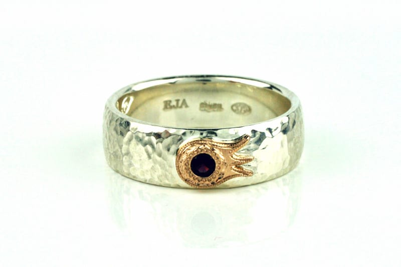 Recycled Sterling Silver anniversary ring with a beaten finish and featuring a stylized pomegranate flower in 18 carat recycled yellow gold as a setting for a US Anthill Garnet - by Ethical Jewellery Australia
