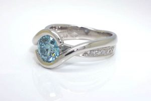Blue lab-grown diamond embrace ring with Argyle accent diamonds