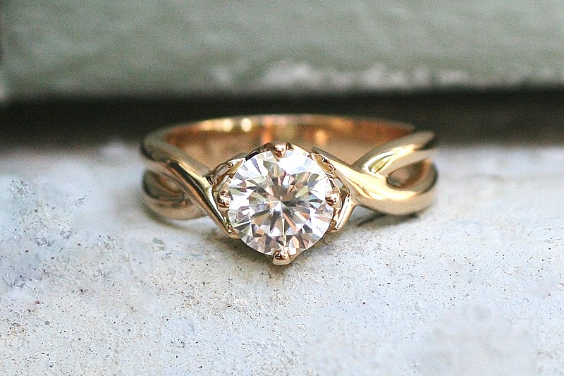 Handmade 18 carat recycled yellow gold crossover style solitaire engagement ring featuring a 6mm moissanite - by Ethical Jewellery Australia