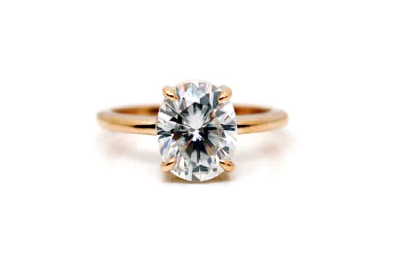 Handmade 18 carat rose gold solitaire engagement ring featuring an oval cut moissanite - by Ethical Jewellery Australia